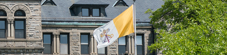 Papal flag in front of McMahon Hall