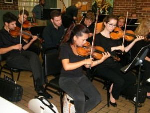 Members of the Symphony Orchestra perform at SOME (So Others Might Eat) Sept. 19.