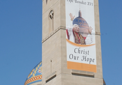 A banner on the bell tower of the Basilica of the National Shrine of the Immaculate Conception welcomes Pope Benedict XVI in 2008.