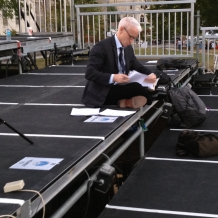CNN's Anderson Cooper prepares for his news show on the media riser.