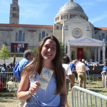 A student with her ticket and the Basilica in the background.
