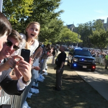 Leaning out over the fence on the University Mall to get a better view of Pope Francis.