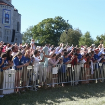The crowd waves as Pope Francis passes by on the University Mall.