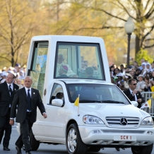 Pope Benedict XVI arrives in the Popemobile on the campus of Catholic University on April 16, 2008.