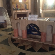 Altar designed by CUA students for the Pope's Mass sits in the Basilica where it is being finished.