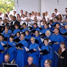 Choir members sing at the Papal Mass.