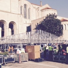 Preparing to raise the roof over the papal altar.