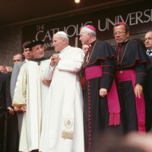 POPE JOHN PAUL II SPEAKS WITH THEN-PRESIDENT OF CATHOLIC UNIVERSITY EDMUND D. PELLEGRINO DURING HIS VISIT IN 1979.